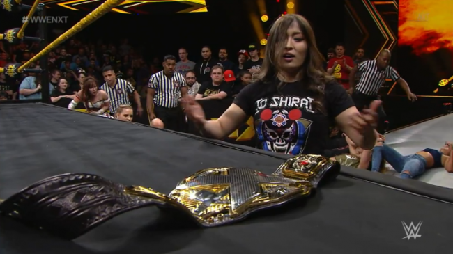 Shirai eyes the Women's Championship sitting on the ring apron after a major brawl in the Women's Division on nXt TV.